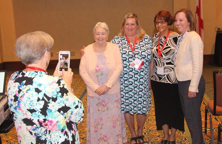 From left, Statewide Early Intervention Coordinator Betsy Prince takes a photo of Julie Beckett, Family Voices co-founder; Susan Colburn, state parent consultant; Melinda Davis, CRS assistant commissioner; and ADRS Commissioner Jane Elizabeth Burdeshaw